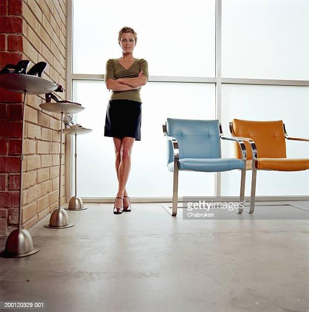 Women standing in shoe store, portrait