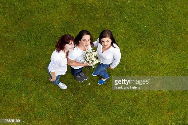 Women standing on grass together