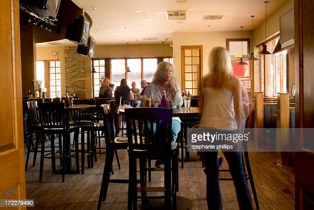 Women Standing Talking in a Pub During the Afternoon