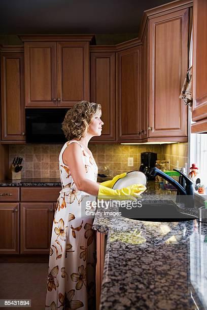 Women standing washing dishes