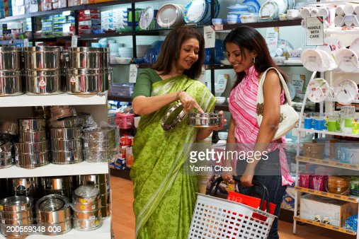 Women standing with basket in supermarket : Stock Photo