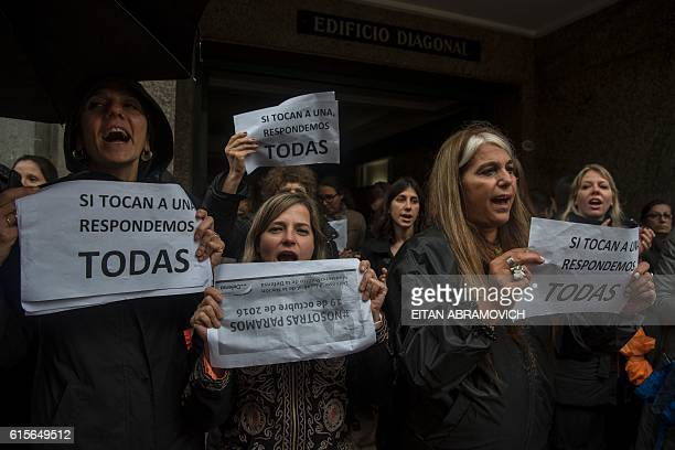 Women stop work and other activities for an hour to join a 'women's strike' organized after the brutal killing of a 16yearold girl in Buenos Aires on...