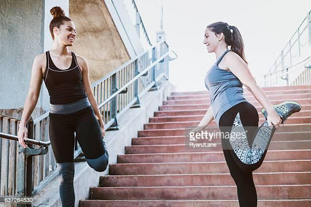 Women Stretching After Run