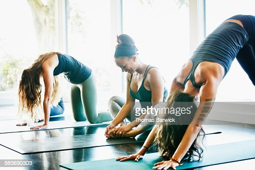 Women stretching before yoga class in studio : Stock Photo