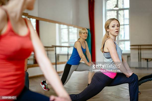 Women Stretching In Aerobics Class