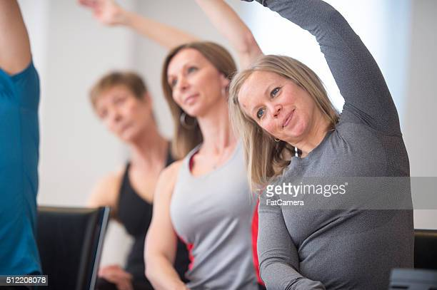 Women Stretching Their Arms Overhead