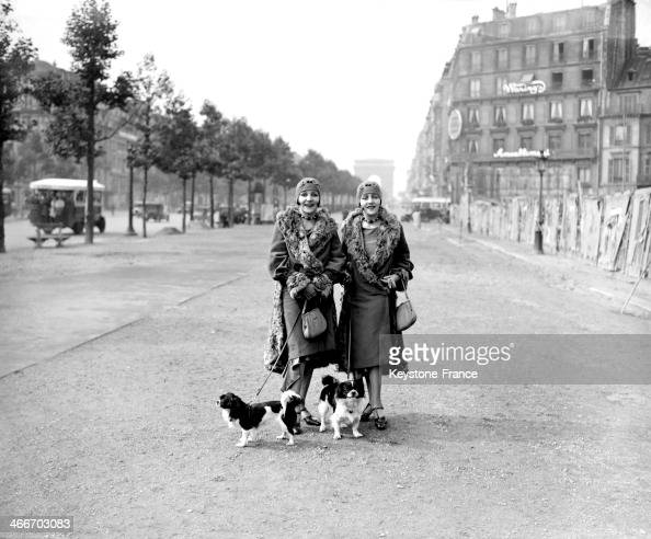 Women strolling on the Champs Elysees in November 1929 in Paris France