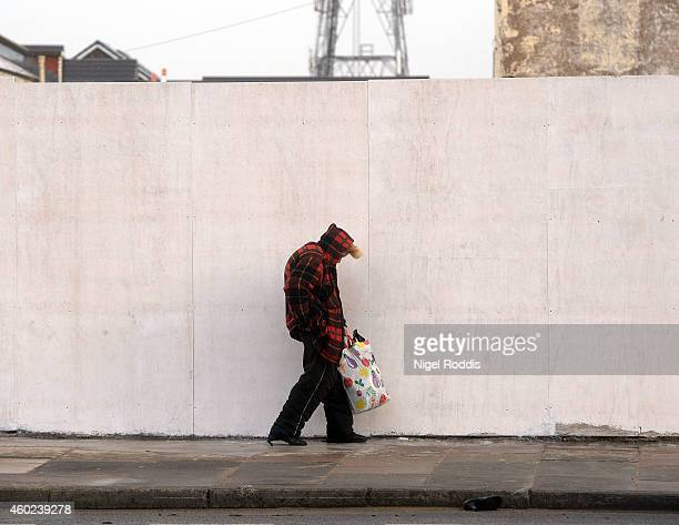 A women struggles to walk along the street against high winds on December 10 2014 in Blackpool United Kingdom High winds and large waves hit the...