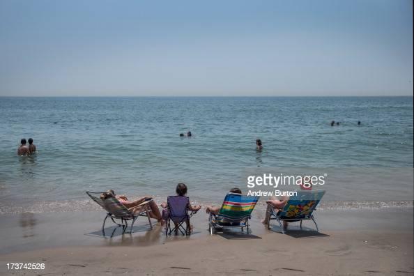 Women sunbathe at Rockaway Beach during a heat wave on July 17 2013 in the Rockaway Beach neighborhood of the Queens borough of New York City...