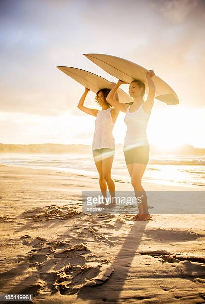 Women surfing at the beach
