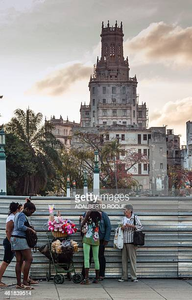 Women surround a street vendor in Havana on January 20 2015 The United States and Cuba will hold their highest level talks in decades on Wednesday...