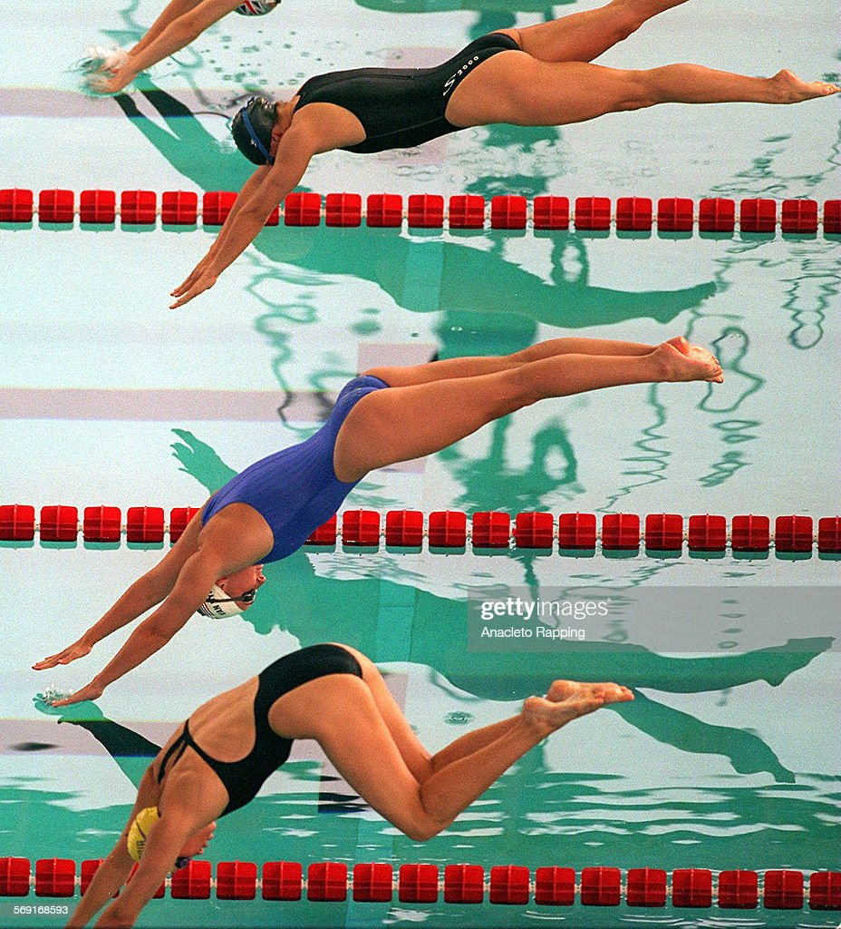 Women swimmers in the 100 meter freestyle make an artistic ...