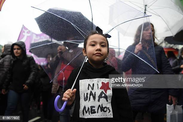 Women take part in a march in Buenos Aires where protesters held a onehour 'women's strike' on October 19 to protest against violence against women...
