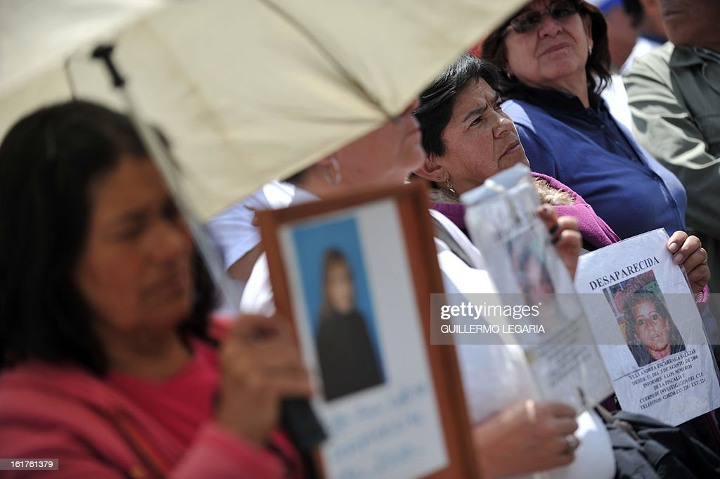 Women take part in a protest against the Revolutionary Armed Forces of Colombia (FARC) guerrillas and to ask for the release of hostages on February 15, 2013 in Bogota, Colombia. The protest aims to reject the latest terrorist attacks and abductions of civil and military people while the guerrillas hold peace negotiations with the government in Havana, Cuba. AFP PHOTO/Guillermo LEGARIA