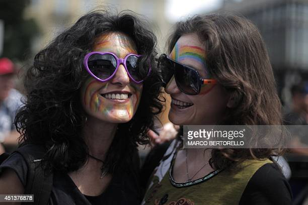 Women take part in the annual Lesbian Gay Bisexual and Transgender Pride Parade in Turin on June 28 2014 AFP PHOTO / MARCO BERTORELLO