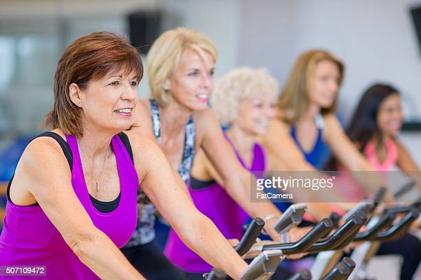 Women Taking a Cycling Class on Stationary Bikes