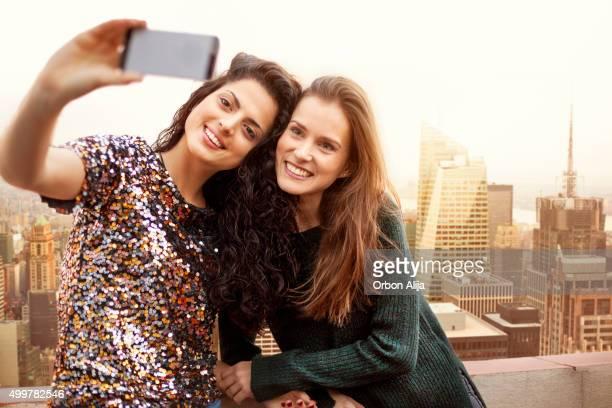 Women taking a Selfie on rooftop