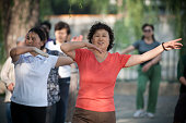 Women taking part in morning exercises in Beihai Park an imperial garden to the northwest of the Forbidden City in Beijing China First built in the...