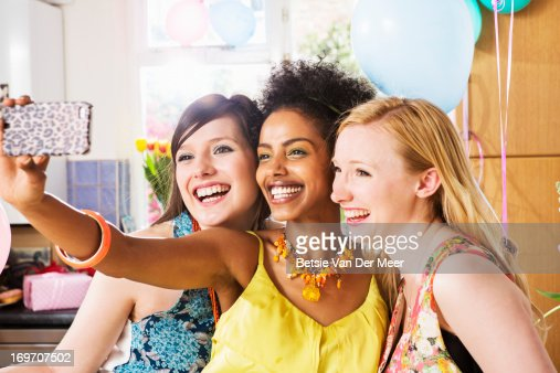 Women taking phones of themselves on phone. : Stock Photo