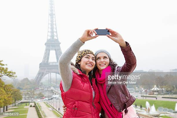 Women taking photo of themselves and Eiffeltower.