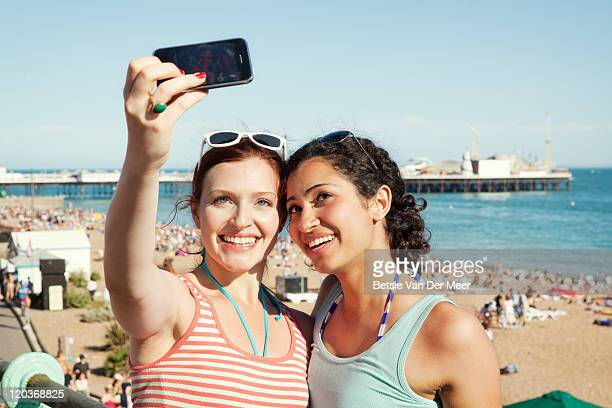 Women taking photograph of themselves on phone