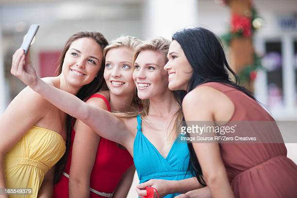 Women taking picture together outdoors