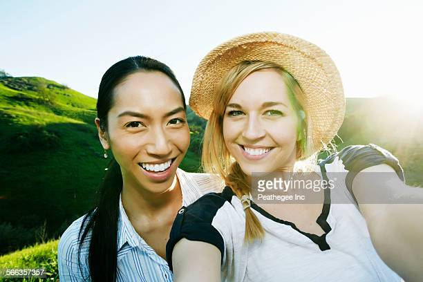 Women taking self portrait on rural hilltop