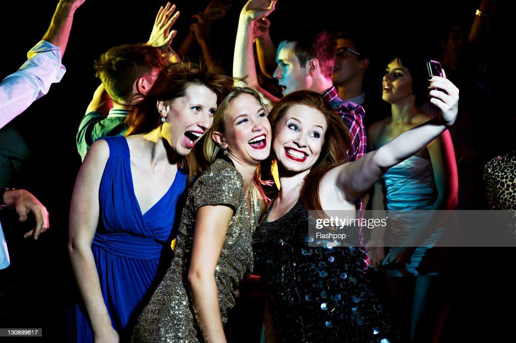 Women taking self portrait with mobile phone : Stock Photo