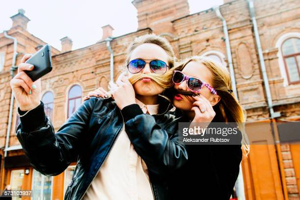 Women taking selfie in city