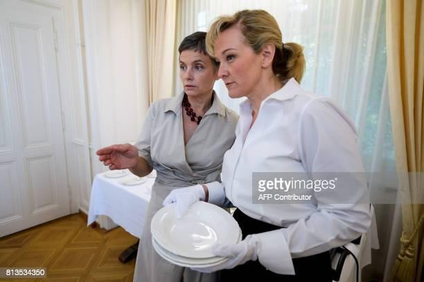 Women talk during a lesson at the Switzerland's last finishing school Institut Villa Pierrefeu on June 26 2017 in Glion Eight women sit primly around...
