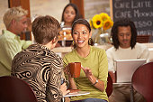 Women talking in coffee house