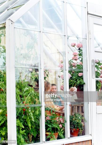 Women talking in greenhouse