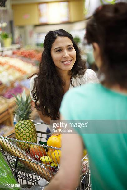 Women talking in grocery store