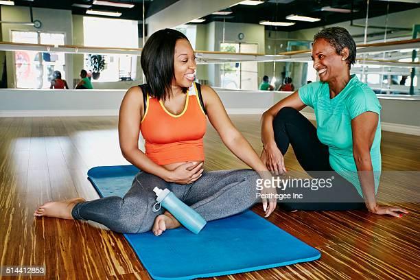 Women talking in yoga studio