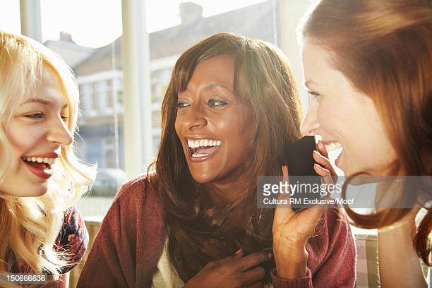Women talking on cell phone together
