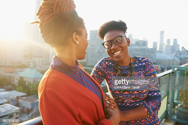 Women talking on city rooftop