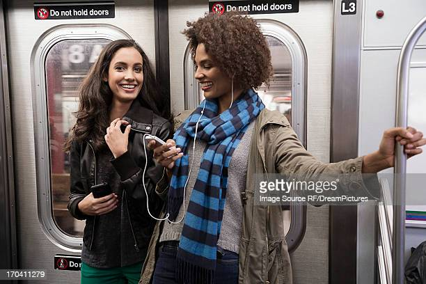 Women talking on subway