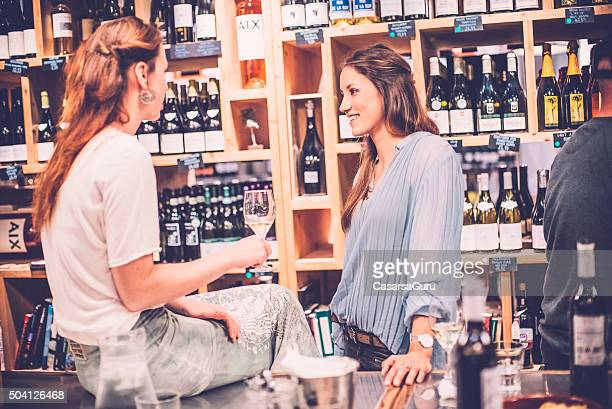 Women Talking to Each Other in a Wine Bar