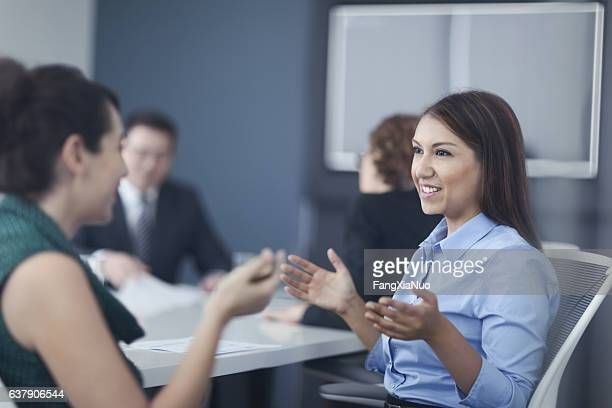 Women talking together in business office meeting