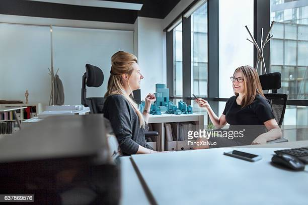 Women talking together in design office
