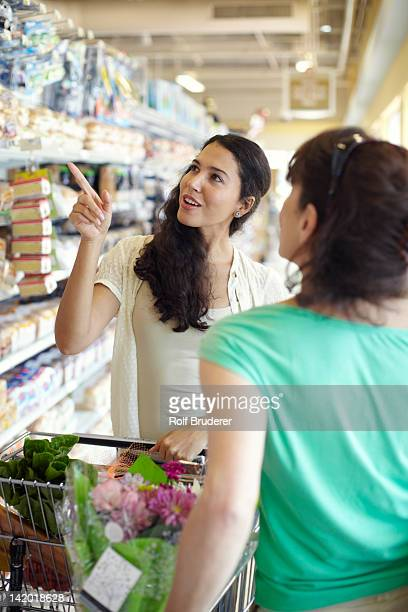Women talking together in grocery store