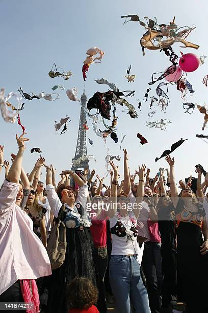 Women throw up their bras on the Parvis des droits de l'homme in Paris on March 25 as they take part in a 'Spring cleaning' event organized by 'Pink...
