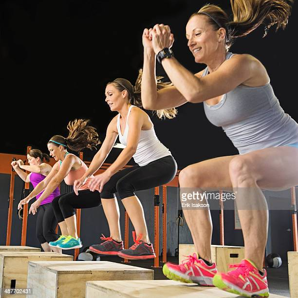 Women training together in gym