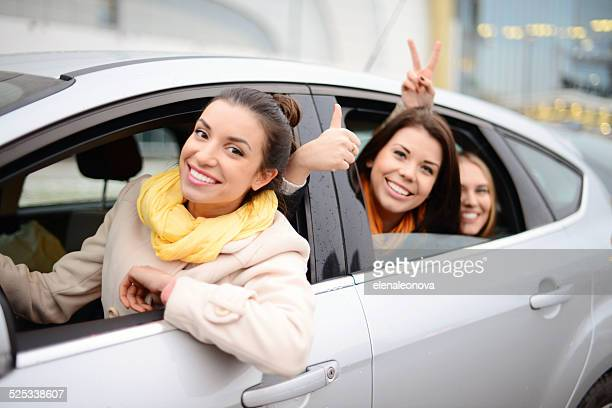 women traveling by car