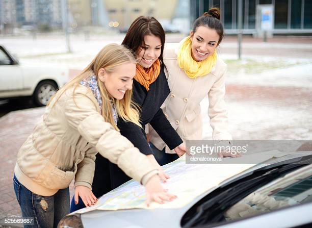 women traveling by car