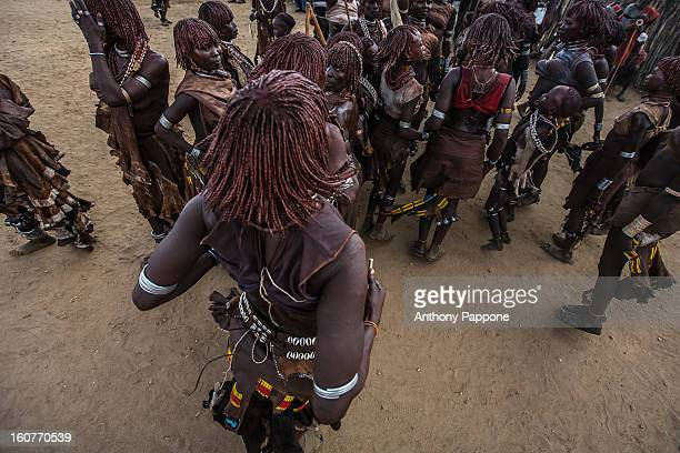 CONTENT] women tribe hamer dancing during the whipping ceremony the women dance and celebrate they are also proudly displaying their whippings Bull...