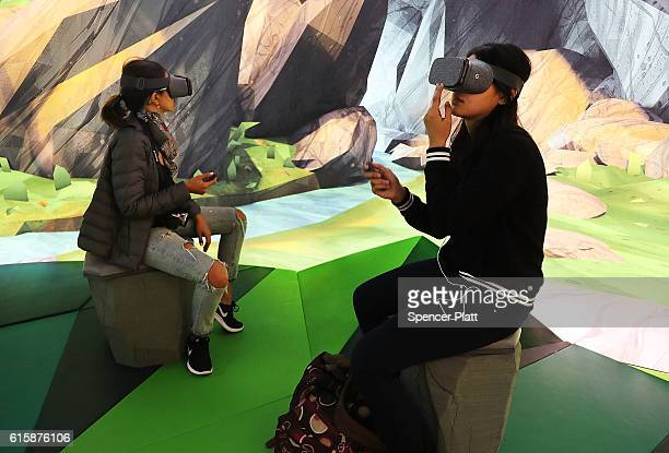 Women try the Google Daydream VR at the new Google popup shop in the SoHo neighborhood on October 20 2016 in New York City The shop lets people try...