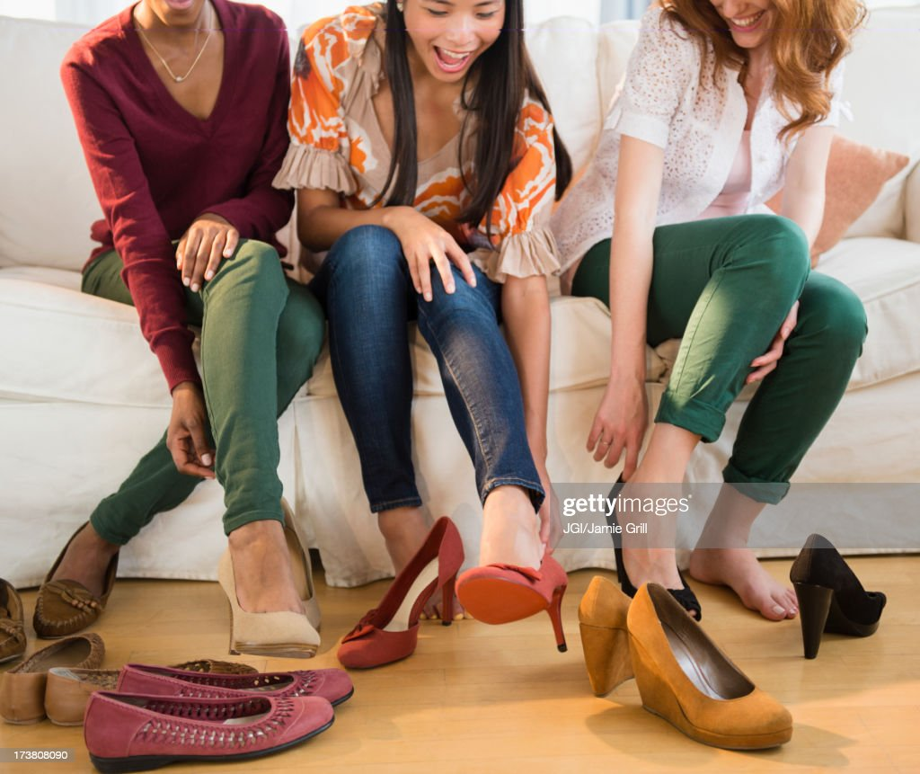 Women trying on shoes together