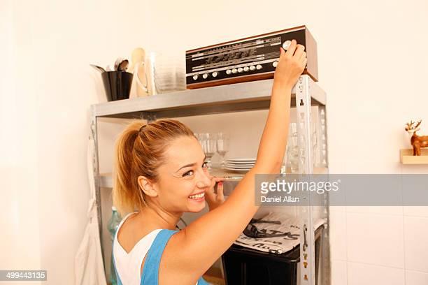 Women tuning radio