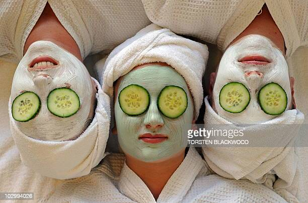 Women undergo facial beauty treatments at the spa on Daydream Island in the Whitsundays archipelago off Queensland on July 12 2010 Australians are...